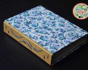 Elegant handmade journal with coiled line stitch with boards covered in authentic florentine paper