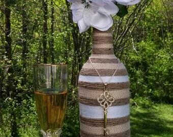 yarn/twine/jute wrapped bottle, Rustic/Bohemian wedding decor, Beach wedding decor, Flower Vase, Centerpieces, decorative bottles