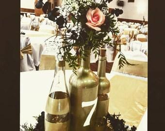 Gold Wine Bottles | striped wine bottles | repurposed wine bottles | wedding centerpieces | wine bottle centerpiece