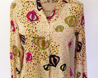 Vintage multicolor silk patterned blouse with notched lapel. Long sleeve gathered cuff with chartreuse bead buttons. Size Large