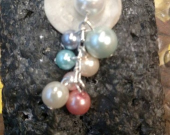 Multi colored pearl and seashell necklace.
