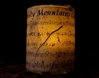 """The Hobbit music """"Misty Mountains Cold"""" Candle holder/ luminary with real leaf paper sheet music"""