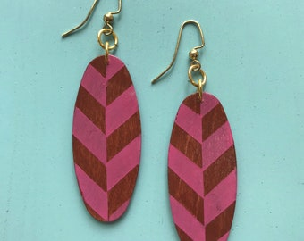 Oval wood earrings painted a pink herringbone pattern