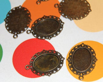 The medium pendant for cabochons 25x18mm color bronze