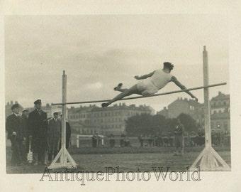 Man athlete in air high jump antique sport photo