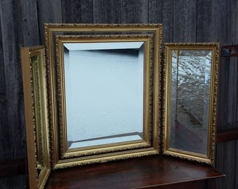 Vintage Triple Swing Mirror ornate gilt bevelled.