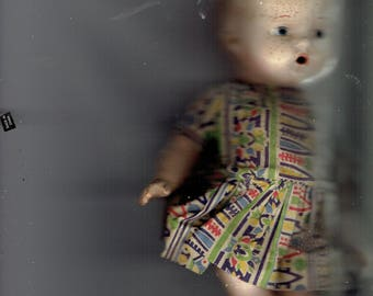 composition doll some damage where legs join.1920's