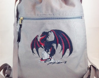 Pigment dyed embroidered cinch bag with dragon embroidery based on the artwork of Ruth Thompson-Soden