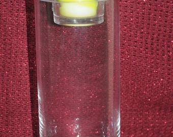 round glass with candle holder vase