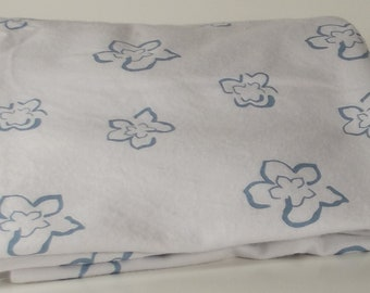 large baby blanket double sided slate blue flower motif, soft cozy white on back