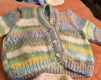 2 new hand knitted babies/dolls 16inch mixed coloured yarn cardigans & 1 pair bootees
