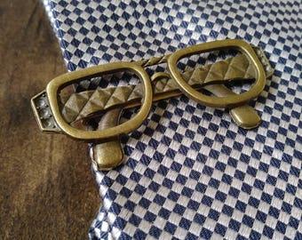 Antique bronze specs tie bar