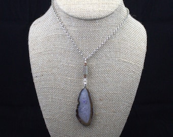 Brown leaf shaped agate with a beautiful white and purple crystalline core on an extended kyanite and hematite handmade bale
