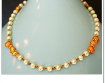 Yellow and white fresh water pearls and 3mm Swarovski crystal