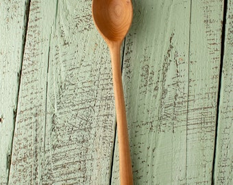 Wooden baking, cooking, and serving spoon handmade in Vermont cherry with round handle and a beautifully grained deep bowl.