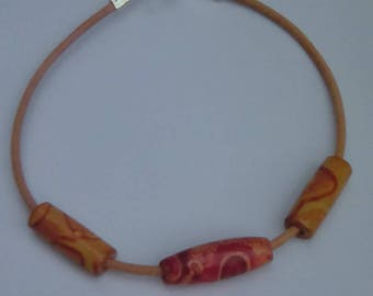 Leather bracelet with three wood beads