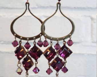 Deep Raspberry chandelier earrings.  Swarovski crystals and antique bronze earring base