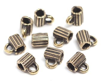 Antique brass findings Bails set brass 10 pieces. Herb, plant, stripe, stripped, 2.3mm cord L3145. Designed and made by Anna Bronze