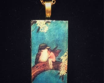 Fairy tales - Wren bird and girl under wing - Domino pendant necklace - vintage matchbox label
