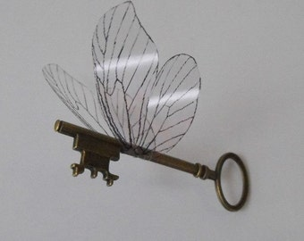 Flying magical key with large butterfly wings in antique brass - ALOLBF