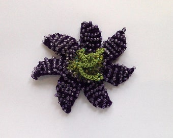 Crocheted and beaded Passion flower brooch in Purple.