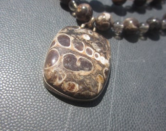 Turritella Agate with Smoky Quartz Necklace: to endure in Time
