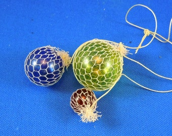 Dollhouse Miniature accessory in twelfth scale or 1:12 scale. 3-pc glass buoys set by Stekowitz.  Item #D474.