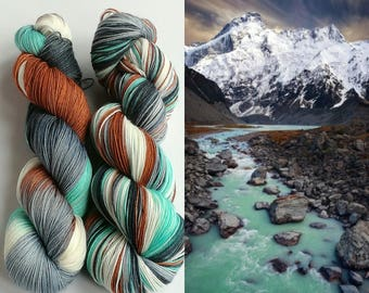 Hand dyed yarn pre-order.  Alpine colourway, variegated wool yarn. Dyed to order. Kettle dyed, you choose base.  White, blue, grey yarn.