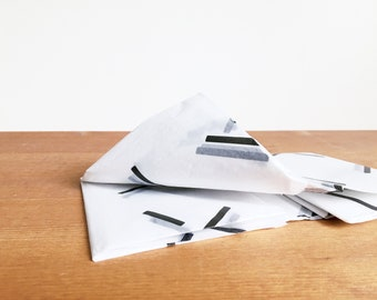 black and white tissue paper: lines, bars, fireworks gift wrap, tissue, stuffing