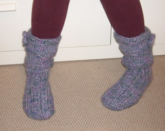 Warm knitted anatomically shaped footies with a crocheted flower