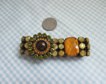 Lovely bracelet with shades of Amber and green stones