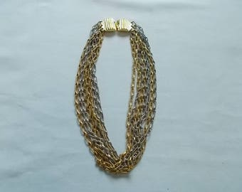 KENNETH LANE.  Gold and Silver Tone Choker Necklace. (631)