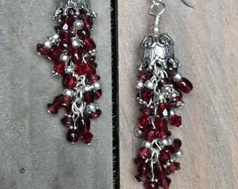 Garnet and glass chandelier earrings.