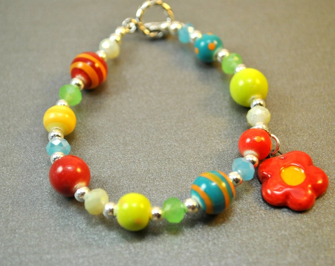 Colorful ceramic bracelet with little flower, sterling silver beads, sterling clasp and crystals