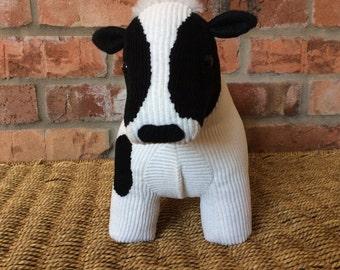 Dora, a friesian cow soft sculpture/doorstop/bookend