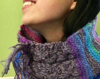 Scarf is hand knit wearable art