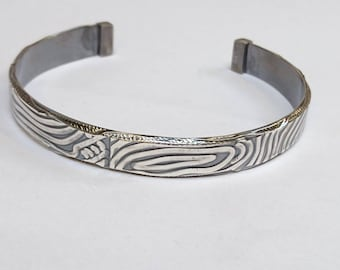 Sterling silver handmade bark textured  men's torque style bangle, hallmarked in Edinburgh