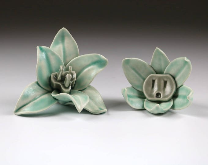 Pair of porcelain Flower Power wall sculptures with outlet and plug