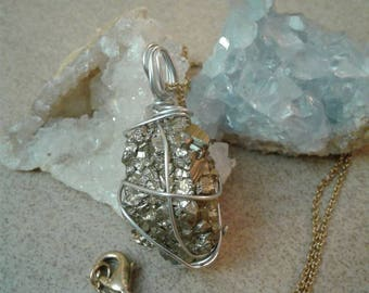 Pyrite  (fools gold) on a gold tone necklace