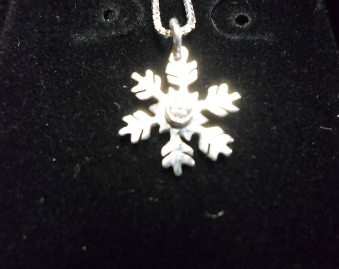 Snowflake necklace dime size w/cz W/sterling silver chain