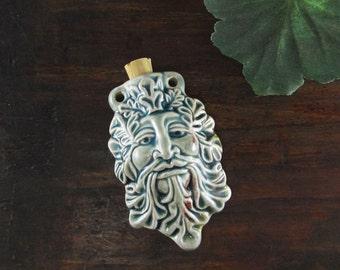 Peruvian Ceramic Raku Green Man Bottle