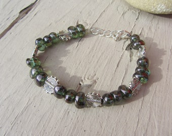 ethnic bracelet, translucent dark green Czech glass beads, haematite ethnic silver tone, green and silver