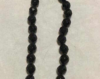 Black Austrian glass necklace marked Austria.