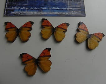 4 wooden 28 x 21 mm black and yellow butterflies