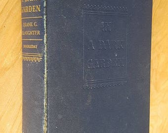 Vintage In A Dark Garden Hardcover Book by Frank G. Slaughter Double Day, yellowed pages, distressed paged, Altered art supply