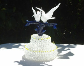 Dove wedding cake top with two Doves on a two-tier base.