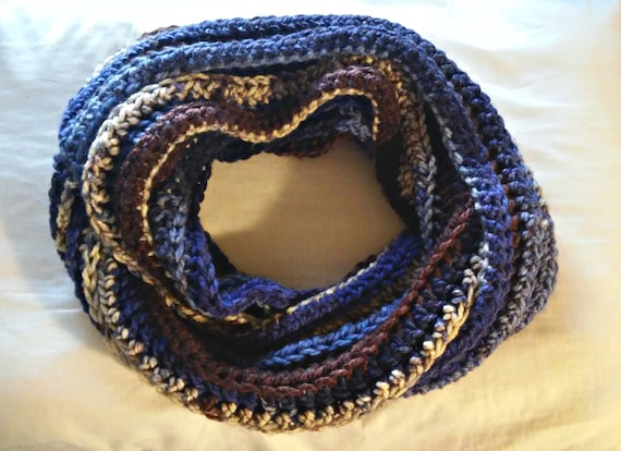 Chunky ribbed crochet infinity scarf in blues, brown, and cream