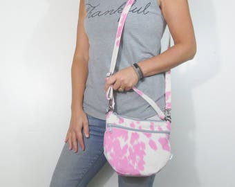pink crossbody purse with zipper closure and zip pocket. pink and white faux suede cow print. handbag. choose zipper color.