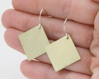 Dangly Brass Earrings. Diamond shaped jewellery in golden brass. Minimalist style earrings in a brushed satin finish for easy wear : BdiDlP.