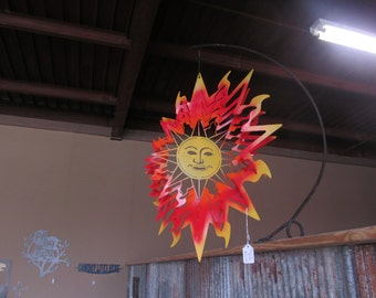 Metal sun spinner  painted on both sides..